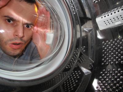 Man looking into washign machine