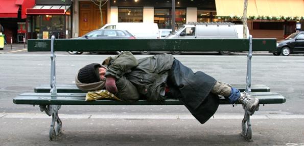 someone sleeping on bench