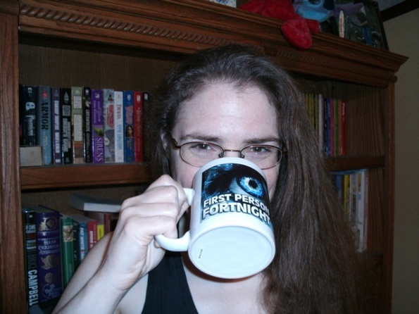 Aimee drinking from mug