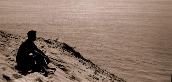 Man sat on a beach